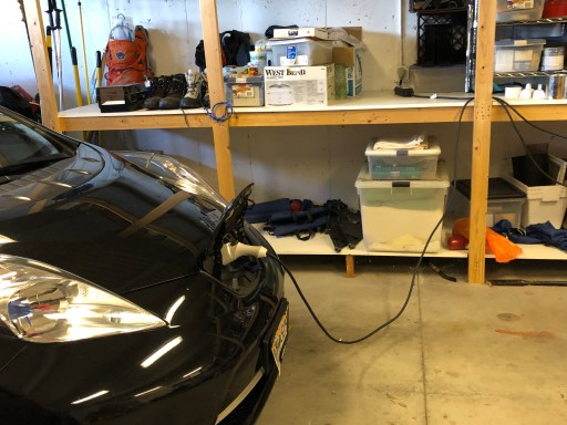 Nissan Leaf plugged into regular wall socket in garage