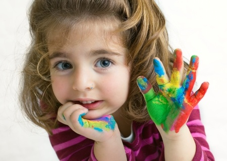 16985504 - preschool girl waving hello goodbye with her hands painted