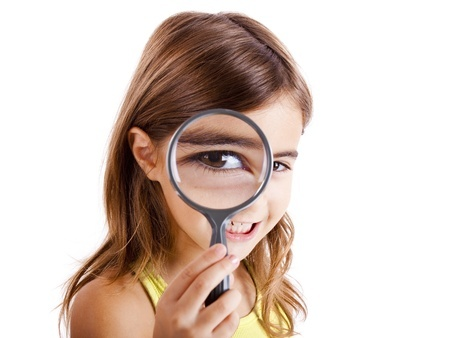 8372448 - beautiful little girl looking through a magnifying glass