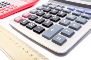 53027908 - accounting and financial calculator on white desk as bookkeeping concept