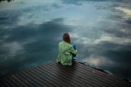 girl sitting by the water