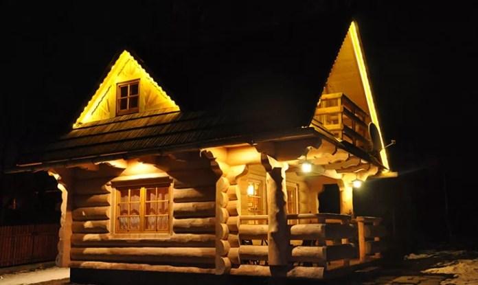 charming-small-log-cabin-exterior-night-01