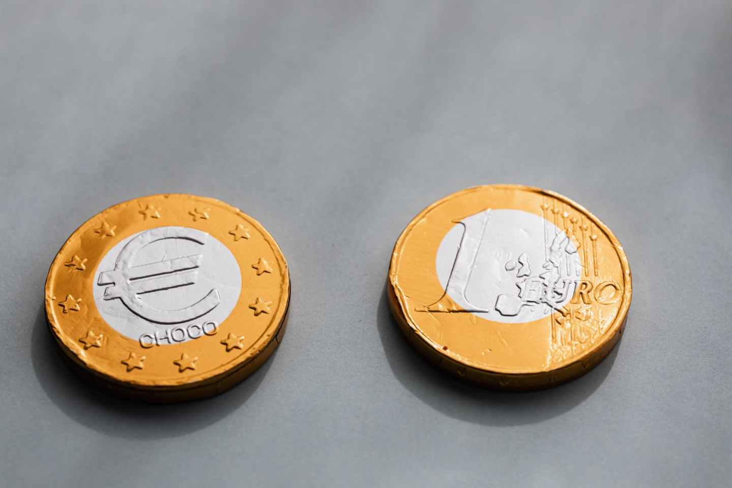coins one euros lying on gray table