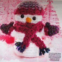 Festive Crochet Snowman Ornament wearing a hat, gloves and scarf