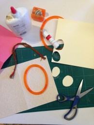 1. Fold A4 coloured card in half and cut out an oval window on one of the halves. I used Tonic shape-mate cutter.