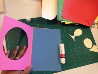 3. Stick another coloured A5 piece of paper onto the solid half of your card.