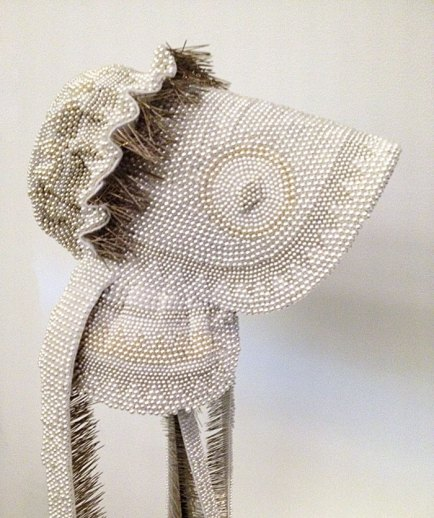 A wedding bonnet made of straight pins