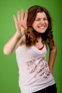 young-girl-showing-four-fingers