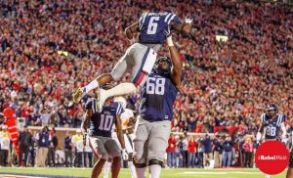 One of Jaylen Walton's touchdowns is celebrated with a lift in the air from Justin Bell. (Photo credit: Bentley Breland, The Rebel Walk)