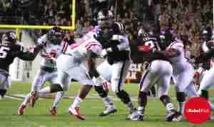 Rebels stop Aggie RB Tra Carson