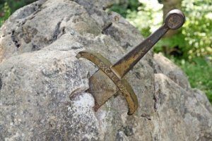 14405792-the-legendary-sword-of-king-arthur-stuck-in-the-rocks