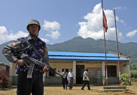 A Myanmar soldier provides security to d