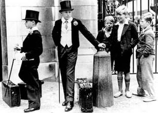 Class divide- Two Eton schoolboys are appraised by three young cockneys outside Lord's in June 1937 as part of class distinction study