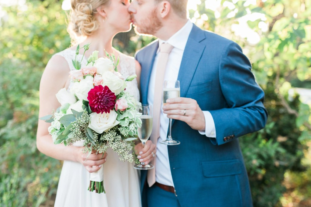 Event julep wedding coordination couple kissing blush and red flower bouquet champagne toast