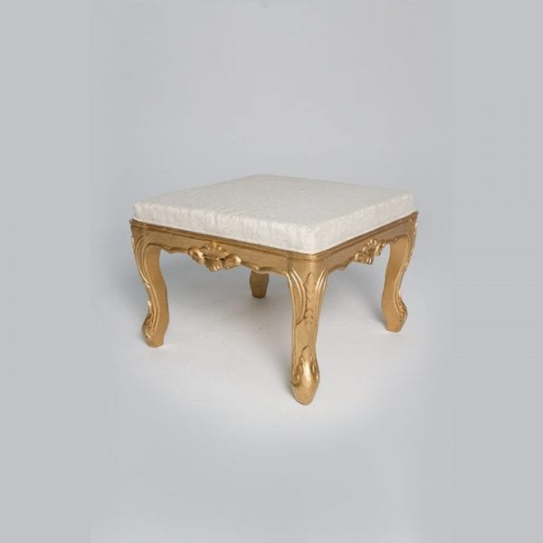 A White Seat cover Wooden Table