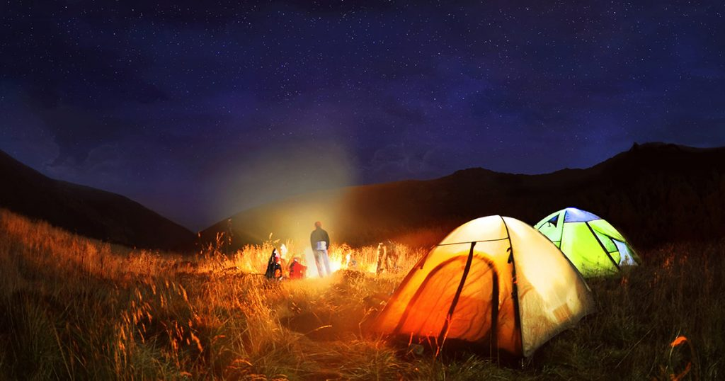 tent camping in a ranch with bonfire