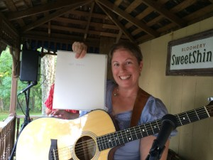 Photo of Carolyn Kelley Klinger with her guitar.