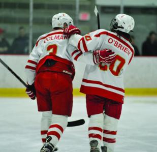Everett High School seniors Ryan Colman and Kevin O'Brien take to the ice for the final time in a Crimson Tide uniform