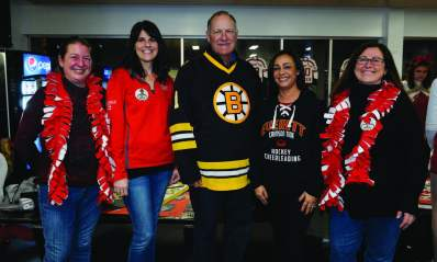 EHS hockey parents Heather Delorey, Michelle Cardinale, Larissa Blauvelt, and Brenda Suppa are pictured with former Boston Bruins goalie Reggie Lemelin.