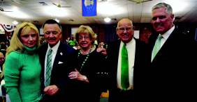 Trisha and Sal Sacro, Judith and Ron Farnell, and Dr. Dennis Leonard enjoy the Friendly Sons of St. Patrick Dinner.