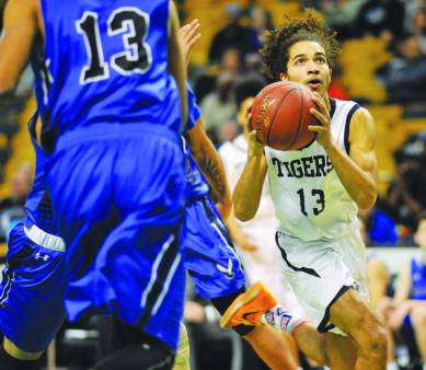 Pope John's Mehkhi Collins (13) drives to the basket.