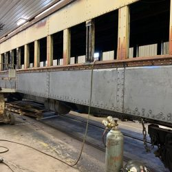 Work continues to install new side sheets onto 994.
