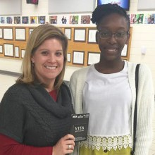 Teacher Dana Burress alongside winning student Lola at Veterans High School