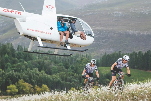 Christoph Sauser and Jaroslav Kulhavý are tracked by the television helicopter as they hunt down the SCOTT-SRAM MTB teams. Photo by Ewald Sadie/Cape Epic/SPORTZPICS.