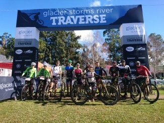A few of the leading riders from the 2017 Glacier Storms River Traverse pose for a finish line photo. From left to right: Mari du Toit, Janine Muller, Vincent Hill, Andrew Robertson, Yolande de Villiers, Paul Fauche, Sarah Hill, Gavin Salt, Jaco Cockrell, Timothy Hoek and Warren Williams. Photo by Seamus Allardice.