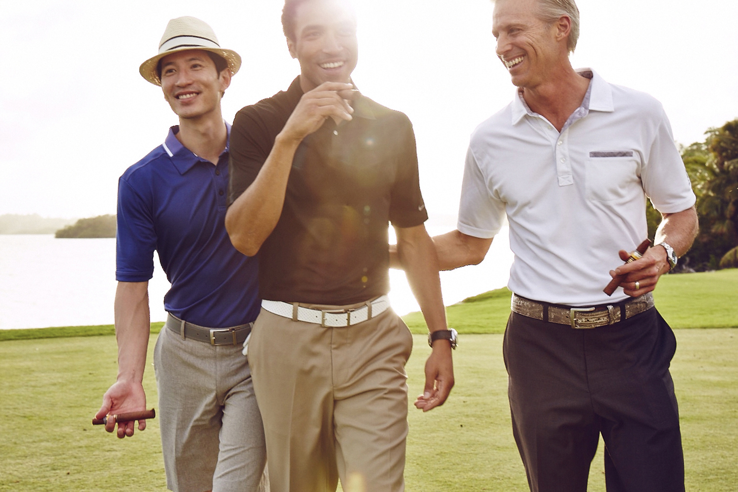 Men smoking cigars on golf course