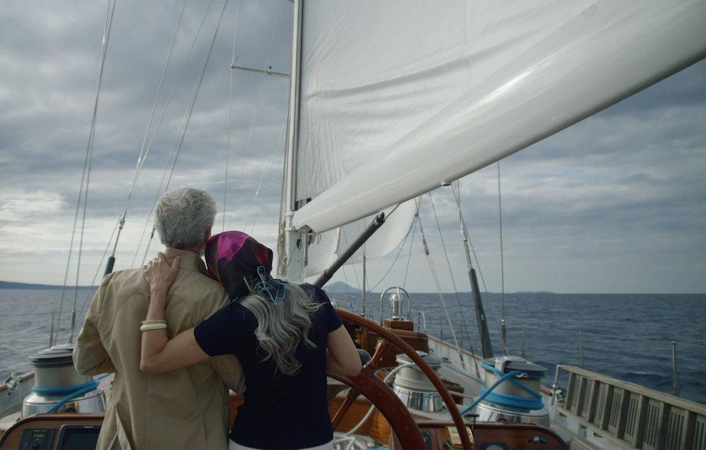 Couple steering yacht