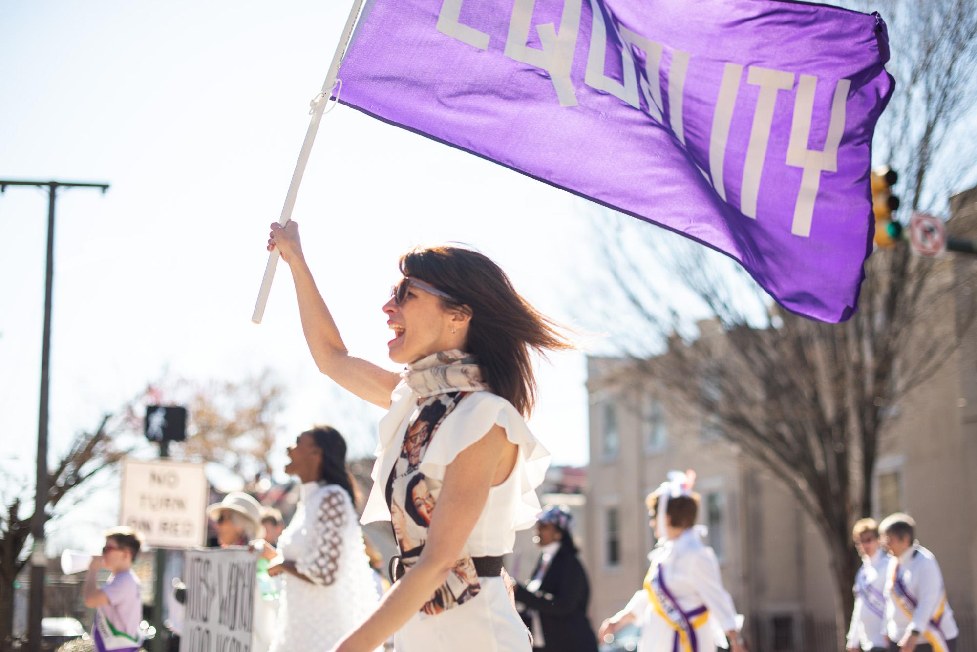 Woman waves 'Equality' flag