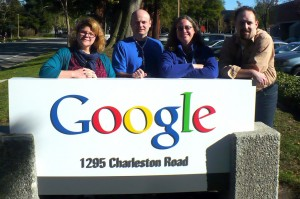 Team Evergreen standing behind the Google sign