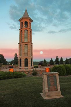 The Bellman Carillon Tower in the Evening with moon in background