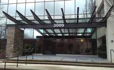 Corporate Campus East required multiple types of signage, including these halo lit address numbers affixed to the front of the building.