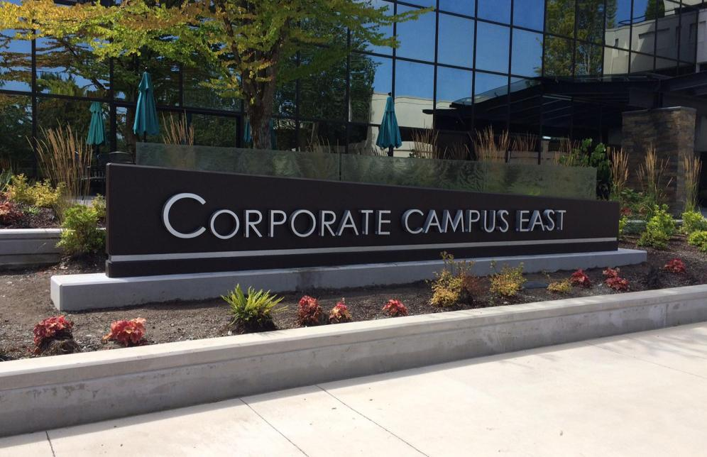 Evergreen created a formed concrete monument sign with halo lit aluminum letters and Onami textured/tempered glass panels for our client at Corporate Campus East.