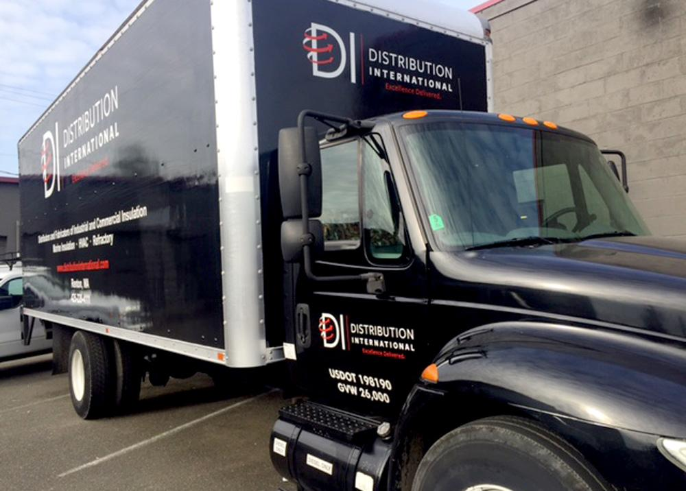 Cut vinyl lettering on both the cab and trailer for this project look seamless and sleek. Fleet graphics don't have to be full coverage to be effective.