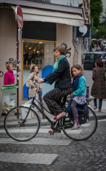 Parisian woman on bike