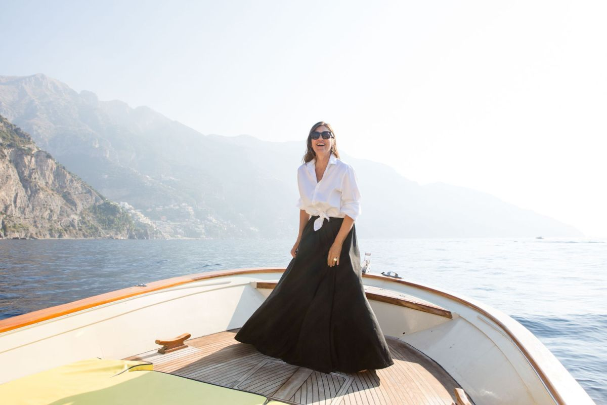 Carla standing near the Italian coastline