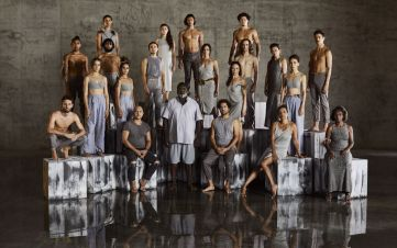 The Bangarra dance company stand together in a studio