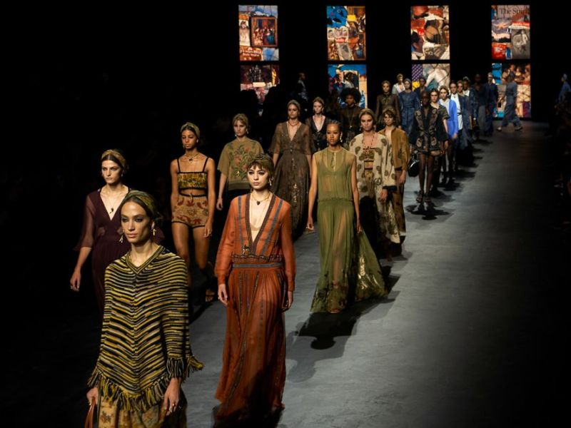 Dior models on the runway at Paris Fashion Week showcasing spring-summer 2021 including dresses, skirts, pants, tops and coats