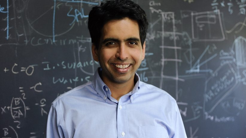 Image: Sal Kahn of the Kahn Academy standing in front of a blackboard full of equaitons