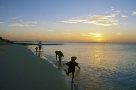 Sunset family beach runners
