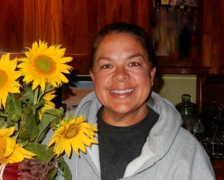 Image: Dr. Lynda and sunflowers