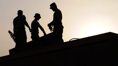 Image: Silhouettes of men working on a roof