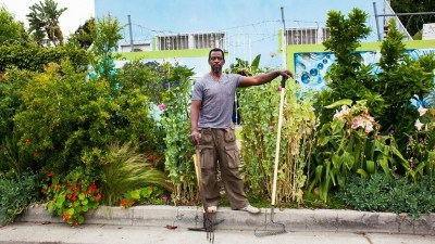 Image: Ron Finley, the Guerrilla Gardner poses in front of his garden