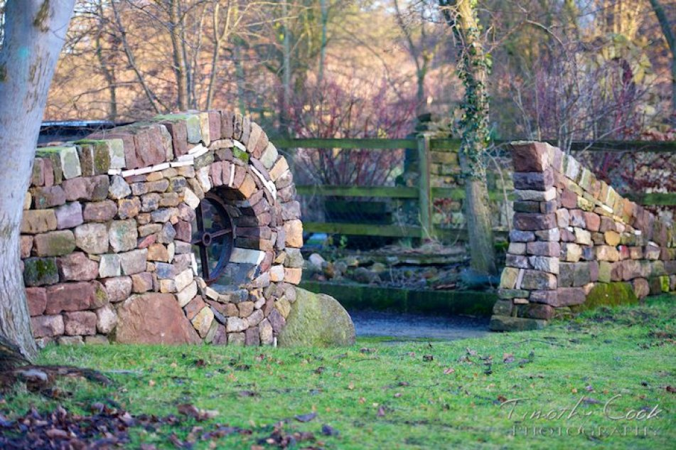Image: Multi-colored tall stone wall