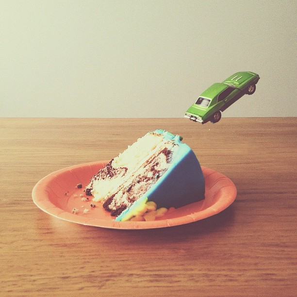Image: Toy car going up a piece of cake like a ramp, Brock Davis Photography