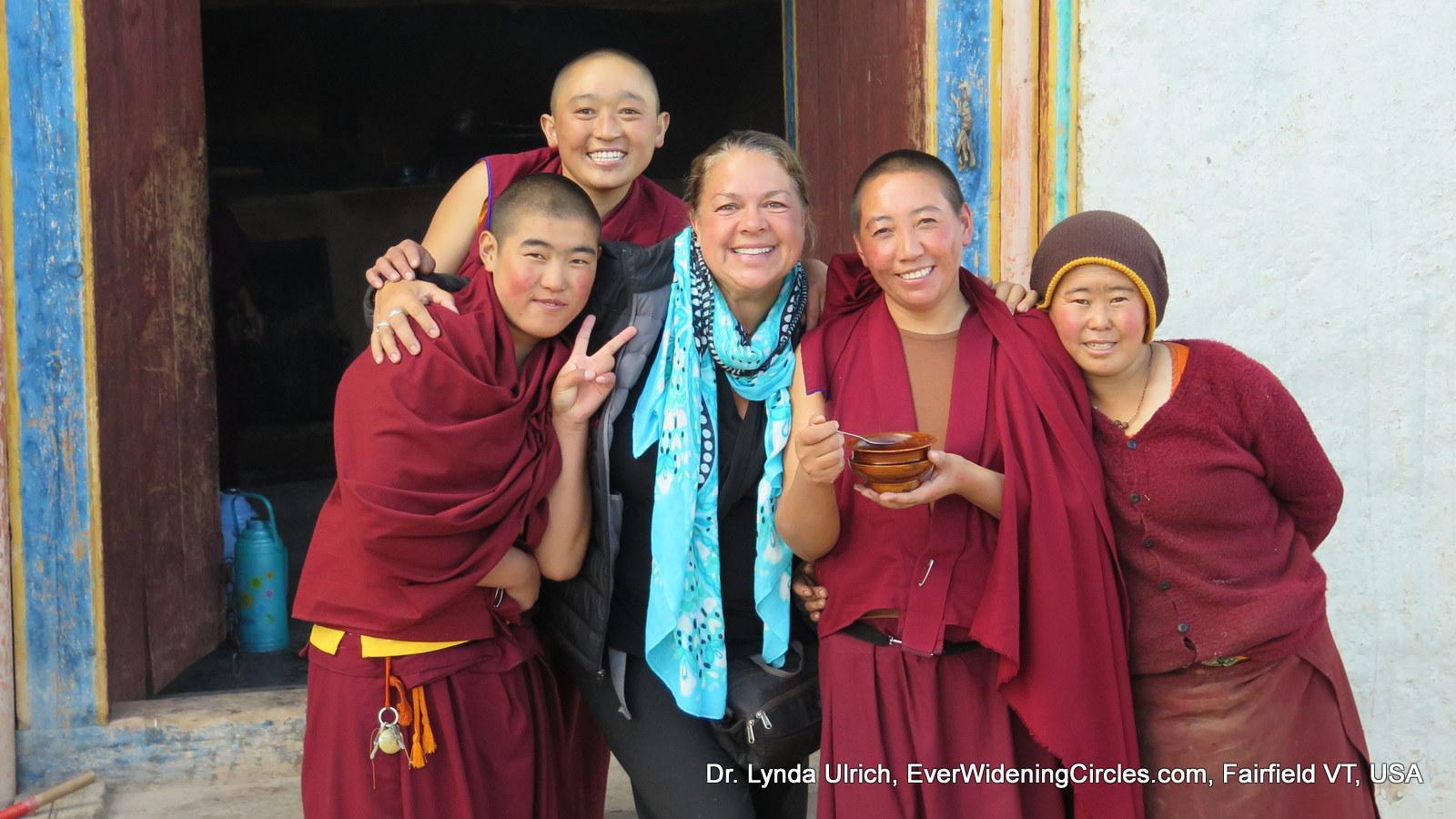 Image: Dr. Lynda with Tibetan nuns, thankful for soup.
