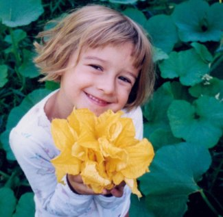 Liesl as a kid with flowers
